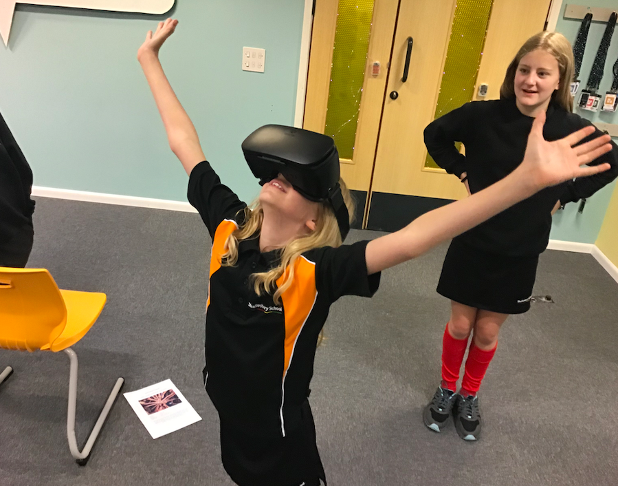 A photo of a girl wearing a VR kit